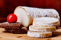 Rondin de brebis with bread and tomato Royalty Free Stock Photo