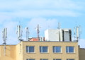 Roof with antennas for mobile signal Royalty Free Stock Images
