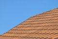 Roof of bituminous tiles against blue sky Stock Images