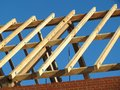 Roof construction wooden logs in blues sky background Stock Photography