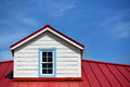 Roof detail house close up a red and a blue sky Royalty Free Stock Photos