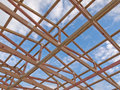 Roof frame construction under cloudy blue sky Royalty Free Stock Photo