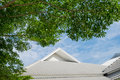 Roof of the house with green tree, blue sky and cloud in vintage Royalty Free Stock Photo