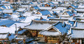 Roof of Jeonju traditional Korean village covered with snow. Royalty Free Stock Photo