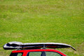 Roof racks for surf table a red truck with Royalty Free Stock Images