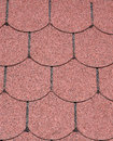 Roof with red bitumen shingles closeup in sunny day Royalty Free Stock Image