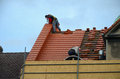 Roof repair two workers on the Royalty Free Stock Photos