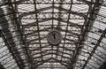 Roof structure of the Paris railway station Gare de l`Est with clock Royalty Free Stock Photo