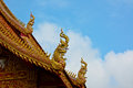 Roof style of thai temple that decorate with naga and blue sky background Stock Images