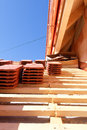 Roof tiles on the roof a under construction with stacks of Royalty Free Stock Photo