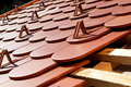 A roof under construction red with snow guards Stock Image