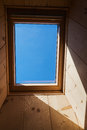Roof window blue sky seen through a Stock Photo