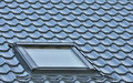 Roof window on a grey tiled rooftop large detailed loft skylight background diagonal roofing pattern Stock Photography