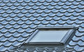 Roof window, grey tiled rooftop, large detailed loft skylight background, diagonal roofing pattern