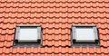 Roof window orange with two classic garret windows Royalty Free Stock Image