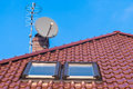 Roof windows chimney and antennas tiled with Royalty Free Stock Photo