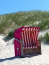 Roofed wicker beach chair on the beach Royalty Free Stock Photo