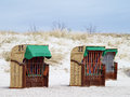 Roofed wicker beach chairs on the beach closed for saeson Royalty Free Stock Photos