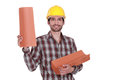 A roofer holding roof tiles Royalty Free Stock Image