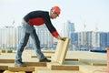 Roofer worker installing roof insulation material builder Stock Image