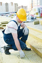 Roofer worker measuring insulation material builder inspecting by tape at roof Stock Images