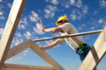 Roofer working on roof structure sunflare Royalty Free Stock Image