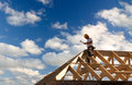 Roofer working on roof structure sunflare Stock Images