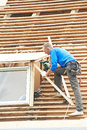 Roofing work with flex roof worker on at works tile material demounting Stock Photography