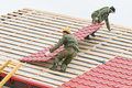Roofing work with metal tile Royalty Free Stock Photo