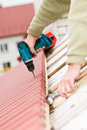 Roofing works with screwdriver Royalty Free Stock Image