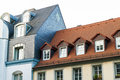 Roofs of old houses with roof windows and orange roof tiles in G Royalty Free Stock Photo