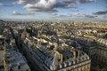 Roofs of paris in a sunny day against the sky with clouds Royalty Free Stock Photos