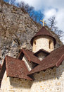 Roofs patterns of a medieval monastery kumanica built close to vertical rock Royalty Free Stock Photos