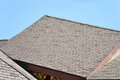 Rooftop a of brown slate shingles in the sun Royalty Free Stock Photography