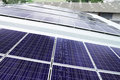 Rooftop Solar Panels on Warehouse Roof Royalty Free Stock Photo