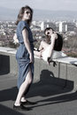 Rooftop two bulgarian bloggers posing for a fashion photo shoot on a in sofia bulgaria Royalty Free Stock Image