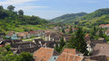 Rooftops of biertan romania and rural landscape village Stock Photography