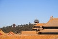 Rooftops Of Buildings Within The Forbidden City With Chinese Pagodas In The Background Royalty Free Stock Photo