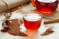 Rooibus tea traditional south africa antioxidant healthy beverage with spices on vintage wooden table in rustic style Royalty Free Stock Photography