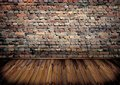 Room with brick wall and wooden floor Royalty Free Stock Photos