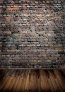 Room with brick wall and wooden floor Royalty Free Stock Photography