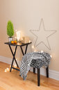 Room with christmas decorations and little green tree Royalty Free Stock Photography
