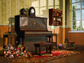 Room with christmas presents an old piano and toys Royalty Free Stock Photography