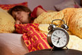 Room clock bed lazy sleep wake Stock Photos