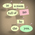 In room full of no be the yes saying quote words a pinned on a bulletin board Royalty Free Stock Images