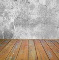 Room interior: grey cement wall with brown wooden floor Royalty Free Stock Photo