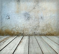 Room interior: grey old painted cement wall with wooden floor Royalty Free Stock Photo