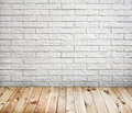 Room interior with white brick wall and wood floor background Stock Photos