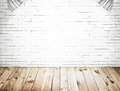 Room interior with white brick wall and wood floor background Stock Photography