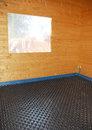 Room with molded insulated panel in eps a a partially constructed wooden house black plastic expanded polystyrene which is used Stock Photo